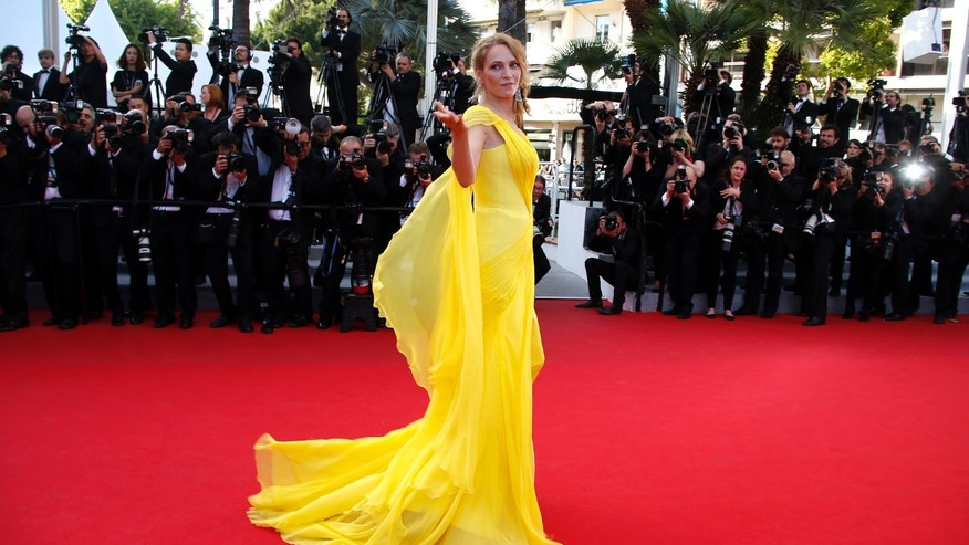 "May 23, 2014. Uma Thurman poses on the red carpet as she arrives for the screening of the film ""Sils Maria"" (Clouds of Sils Maria) in competition at the 67th Cannes Film Festival in Cannes."