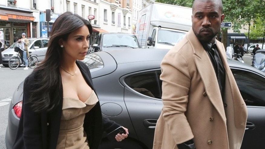 May 21, 2014: Kim Kardashian and U.S rap singer Kanye West arrive at a luxury shop in Paris. (AP)