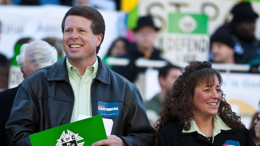 January 14, 2012. Jim Bob Duggar (L) and his wife Michelle Duggar (R), supporters of Republican presidential candidate and former Pennsylvania Senator Rick Santorum, attend a Pro-Life rally  in Columbia, South Carolina, on the steps of the State House.