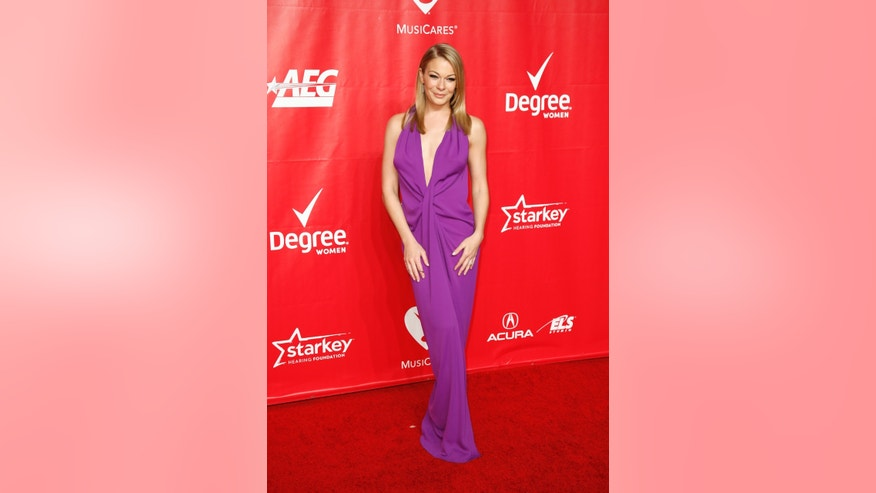 January 24, 2014. Singer LeAnn Rimes poses at the 2014 MusiCares Person of the Year gala honoring Carole King in Los Angeles.
