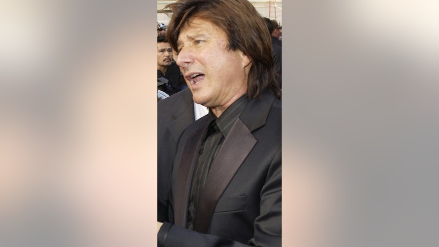 January 21, 2005. Steve Perry (R), former lead singer in the rock band Journey, signs autographs following an unveiling ceremony honoring the group with the 2,275th star on the Hollywood Walk of Fame.
