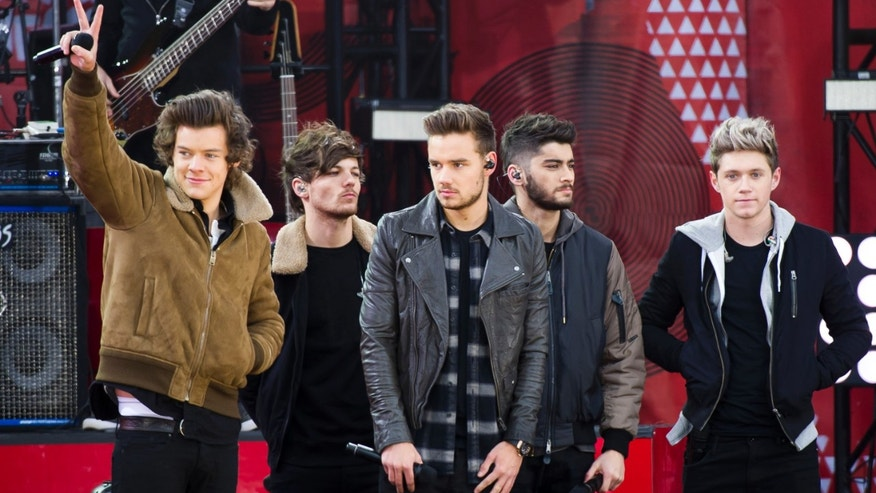 """Nov. 26, 2013. One Direction members, from left, Harry Styles, Louis Tomlinson, Liam Payne, Zayn Malik and Niall Horan on ABC's """"Good Morning America"""" in New York."""