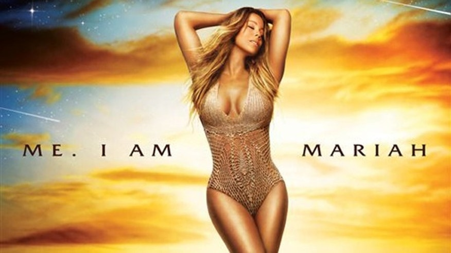 "This CD cover image released by Def Jam Records shows ""Me. I Am Mariah⦠The Elusive Chanteuse"" by Mariah Carey. (AP Photo/Def Jam Records)"
