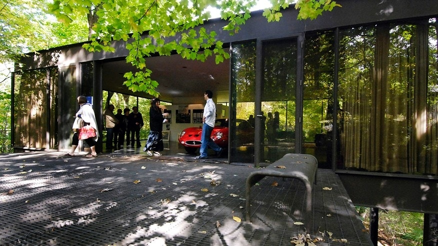 "This Oct. 4, 2009 photo shows visitors touring the pavilion in the back of the modernist home in Highland Park, Ill., that was featured in the movie ""Ferris Bueller's Day Off."""