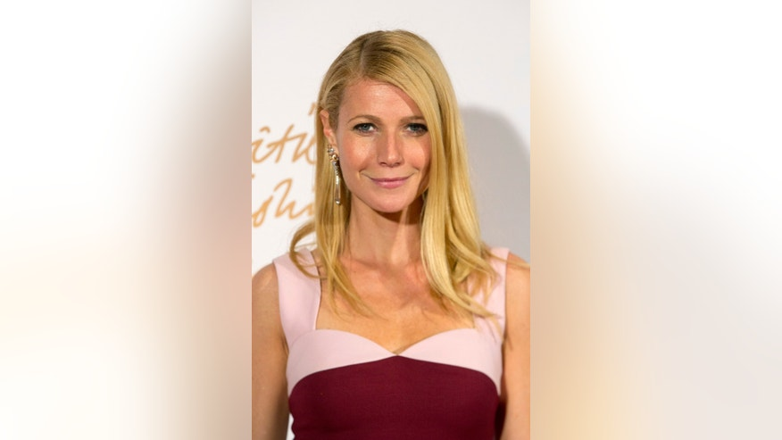 December 2, 2013. Gwyneth Paltrow poses at the British Fashion Awards in London.