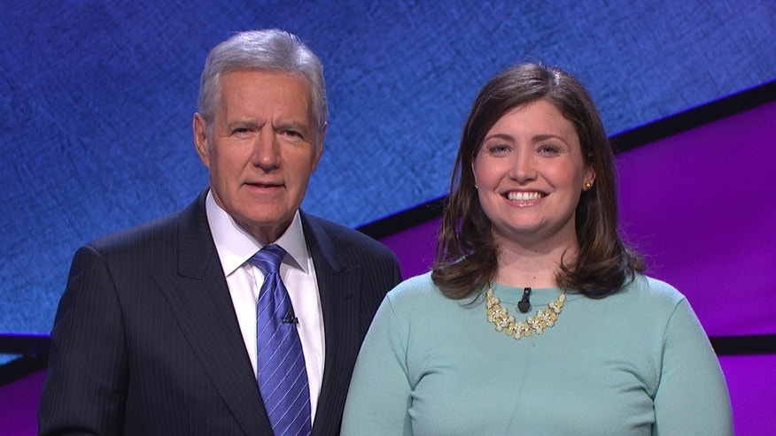 "January 2014. Alex Trebek, left, host of the TV show ""Jeopardy!"" poses with contestant Julia Collins, 31, of Kenilworth, Ill., during the taping of her shows."