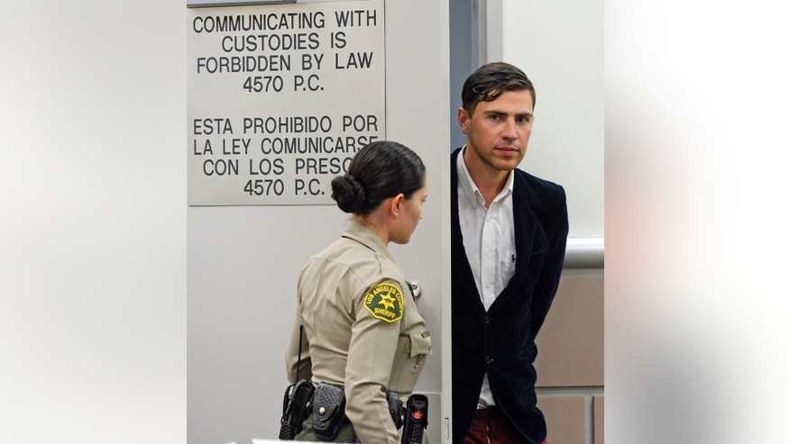 May 30, 2014. Vitalii Sediuk, from Ukraine, is led into the courtroom in Los Angeles Superior Court  Friday, May 30, 2014, in Los Angeles. Sediuk faces four misdemeanor charges in connection with an alleged May 28 attack on actor Brad Pitt at a Los Angeles movie premiere.