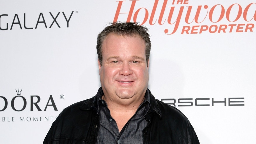 September 19, 2013. Actor Eric Stonestreet arrives at The Hollywood Reporter's Emmy party in West Hollywood, California.