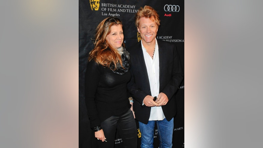 January 12, 2013. Musician Jon Bon Jovi and wife Dorothea Hurley arrive at the British Academy of Film and Television Arts Los Angeles awards season Tea Party in Los Angeles, California.