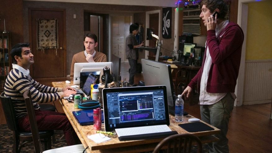 "Kumail Nanjiani, Zach Woods, and Thomas Middleditch, in a scene from the television series,""Silicon Valley."""