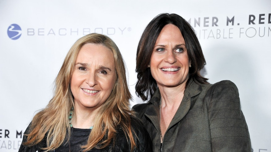 November 14, 2013. Melissa Etheridge, left, and Linda Wallem arrive at the 6th Annual Go Go Gala at the Bel Air Bay Club, California.