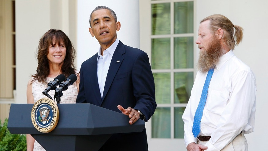 President  Obama stands with Bob Bergdahl (R) and Jami Bergdahl (L) as he delivers a statement about the release of their son, prisoner of war U.S. Army Sergeant Bowe Bergdahl, in the Rose Garden at the White House in Washington May 31, 2014.