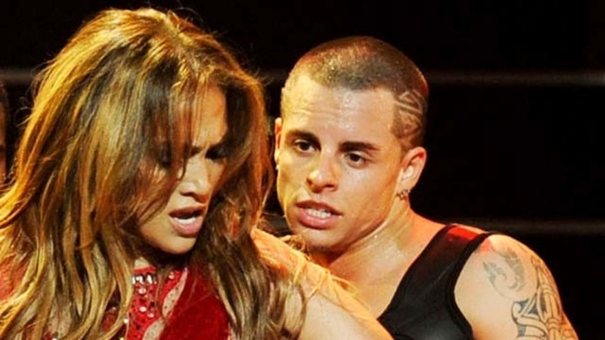 LAS VEGAS, NV - SEPTEMBER 24:  Singer Jennifer Lopez and dancer Casper Smart (3R) perform onstage at the iHeartRadio Music Festival held at the MGM Grand Garden Arena on September 24, 2011 in Las Vegas, Nevada.  (Photo by Ethan Miller/Getty Images for Clear Channel)