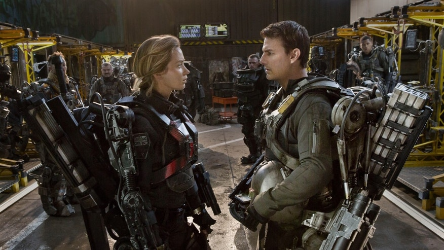 "This image released by Warner Bros. Pictures shows Emily Blunt, left, and Tom Cruise in a scene from ""Edge of Tomorrow."""