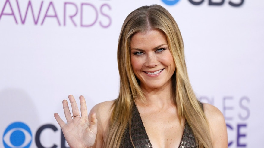 "Alison Sweeney of the television series ""The Biggest Loser"" arrives at the 2013 People's Choice Awards in Los Angeles, January 9, 2013.   REUTERS/Danny Moloshok (UNITED STATES  - Tags: ENTERTAINMENT)  (PEOPLESCHOICE - ARRIVALS) - RTR3C9ET"
