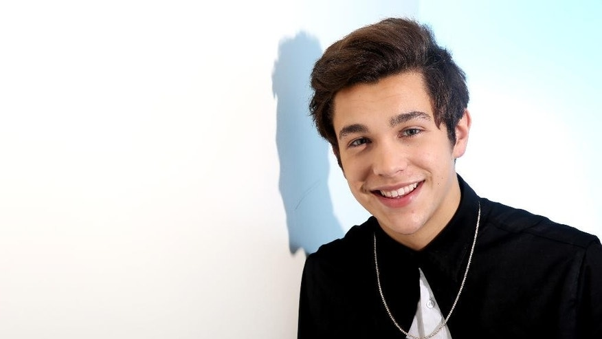 "In this Thursday, May 29, 2014 photo, singer Austin Mahone poses for a portrait in Los Angeles. His EP ""The Secret"" released on May 23, 2014. (Photo by Matt Sayles/Invision/AP"