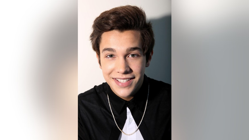 "In this Thursday, May 29, 2014 photo, singer Austin Mahone poses for a portrait in Los Angeles. His EP ""The Secret"" released on May 23, 2014. (Photo by Matt Sayles/Invision/AP)"