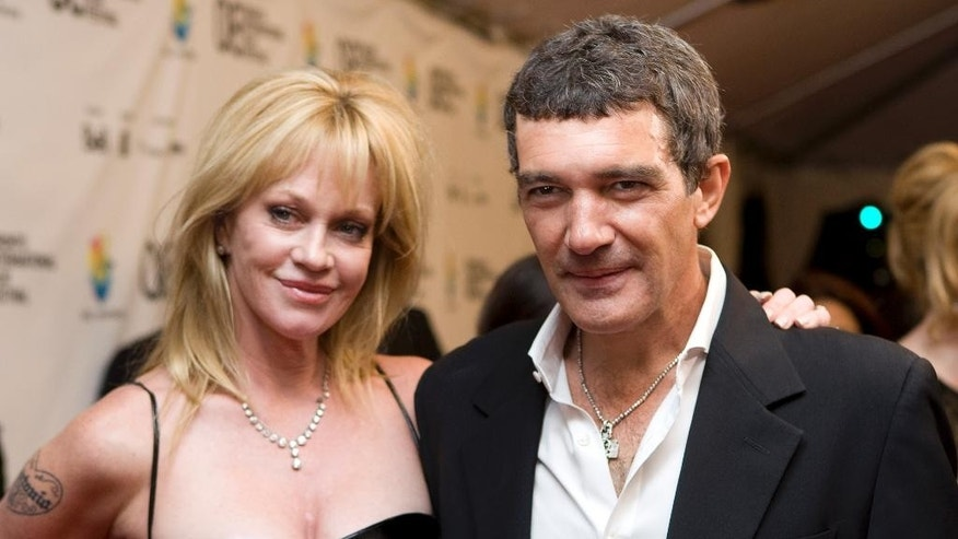 "FILE - This Sept. 7, 2008 file photo shows actors Antonio Banderas, right, and his wife Melanie Griffith at the Gala premier of ""The Other Man"" at the Toronto International Film Festival in Toronto. Griffith filed for divorce from Banderas on Friday June 6, 2014 in Los Angeles, citing irreconcilable differences as the reason for the end of their 18-year marriage. (AP Photo/Jonathan Hayward, CP, FIle)"