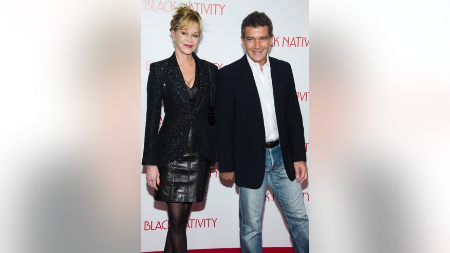 "FILE - This Nov. 18, 2013 file photo shows actors Melanie Griffith, left, and Antonio Banderas at the ""Black Nativity"" premiere in New York. Griffith filed for divorce from Banderas on Friday June 6, 2014 in Los Angeles, citing irreconcilable differences as the reason for the end of their 18-year marriage. (Photo by Charles Sykes/Invision/AP, File)"