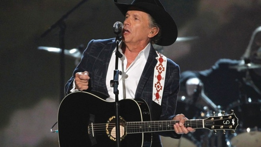 "April 6: George Strait performs ""I Got a Car"" at the 49th Annual Academy of Country Music Awards in Las Vegas, Nevada."