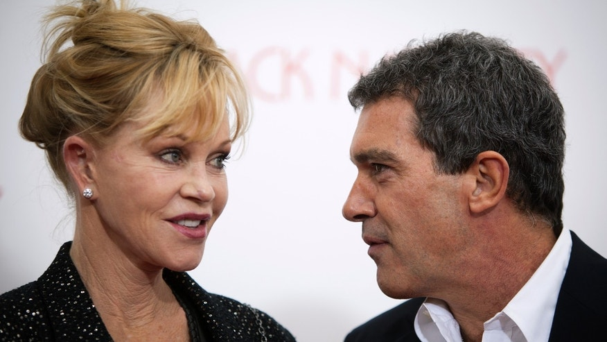 "November 18, 2013. Antonio Banderas and wife Melanie Griffith arrive for the premiere of the movie ""Black Nativity"" at the Apollo Theatre in New York."