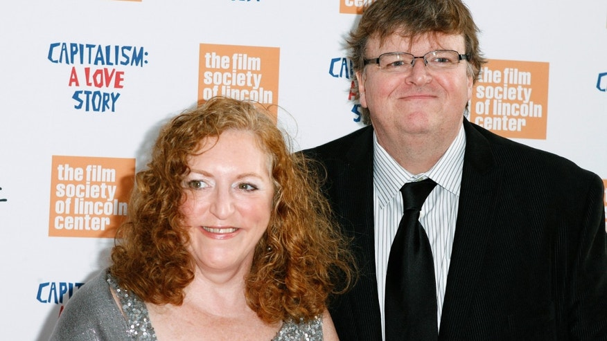 "September 21, 2009. Director Michael Moore arrives with his wife Kathleen Glynn to attend a screening of the film ""Capitalism: A Love Story"" in New York."