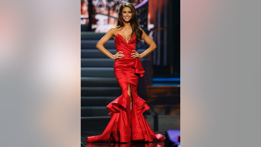 Miss Nevada Nia Sanchez takes the runway during the evening gown portion of the 2014 Miss USA beauty pageant in Baton Rouge, Louisiana June 8, 2014. Fifty-one state titleholders compete in the swimsuit, evening gown and interview categories for the title of Miss USA 2014 during the 63rd annual Miss USA competition.   REUTERS/Adrees Latif   (UNITED STATES - Tags: ENTERTAINMENT SOCIETY) ATTENTION EDITORS - FOR EDITORIAL USE ONLY. NOT FOR SALE FOR MARKETING OR ADVERTISING CAMPAIGNS - RTR3ST9X