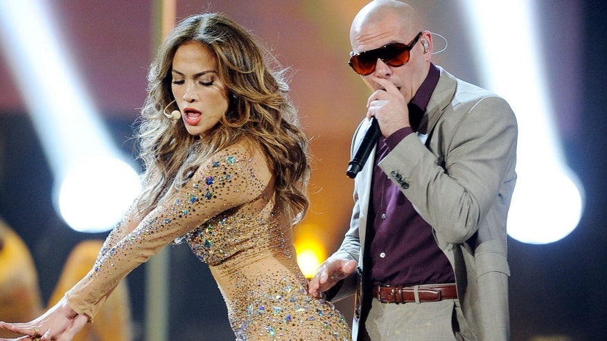 Jennifer Lopez and rapper Pitbull at the 2011 American Music Awards on November 20, 2011 in Los Angeles, California.
