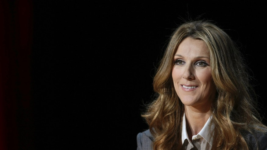 Singer Celine Dion listens to a question from a reporter following her opening night performance at the Colosseum at Caesars Palace in Las Vegas, Nevada March 15, 2011.