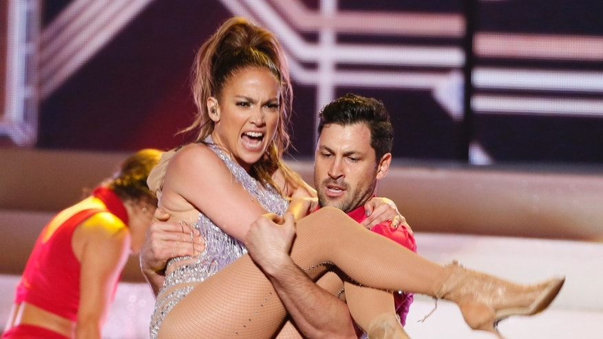 Jennifer Lopez and Maksim Chmerkovskiy perform a tribute to singer Celia Cruz at the 41st American Music Awards in Los Angeles, California
