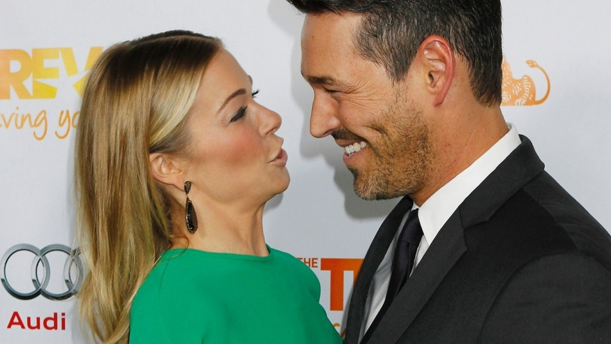 "Singer LeAnn Rimes speaks to her husband actor Eddie Cibrian as they arrive at The Trevor Project's ""Trevor Live"" fundraising dinner in Hollywood December 4, 2011. The Trevor Project provides crisis intervention and suicide prevention services to lesbian, gay, bisexual and transgender young people under the age of 24. REUTERS/Fred Prouser (UNITED STATES - Tags: ENTERTAINMENT SOCIETY) - RTR2UUXL"