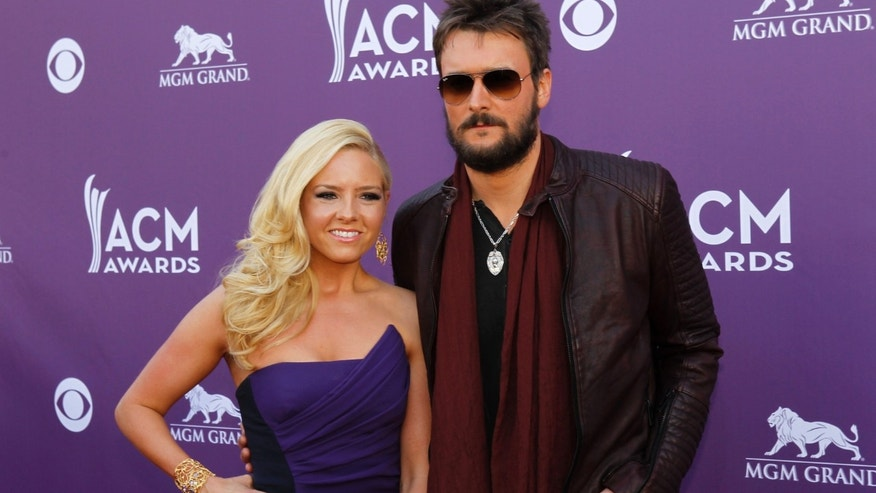 Singer Eric Church and his wife Katherine arrive at the 48th ACM Awards in Las Vegas April 7, 2013. REUTERS/Steve Marcus (UNITED STATES  Tags: Entertainment) (ACM-ARRIVALS) - RTXYCL1