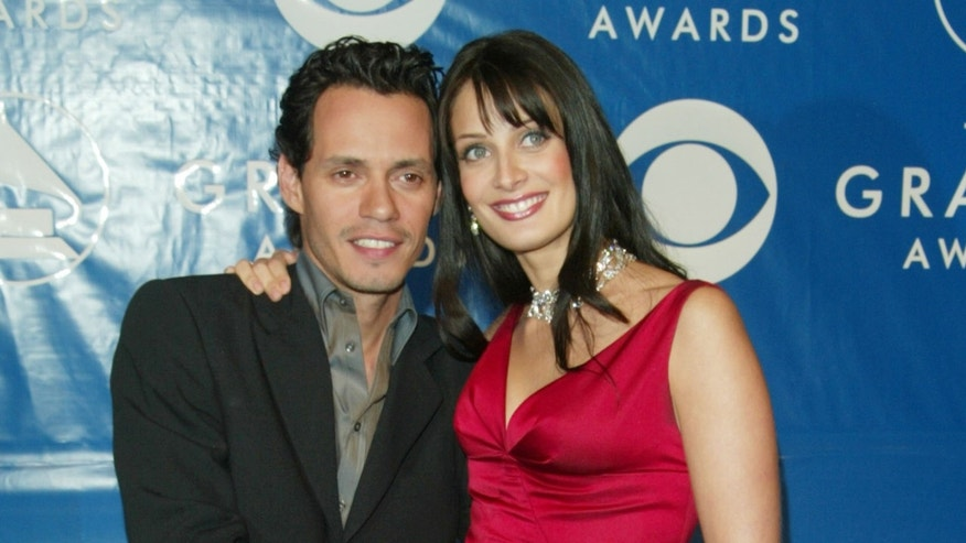 NEW YORK - FEBRUARY 23:  Marc Anthony and his wife Dayanara Torres attend the 45th Annual Grammy Awards at Madison Square Garden on February 23, 2003 in New York City.  (Photo by Evan Agostini/Getty Images)