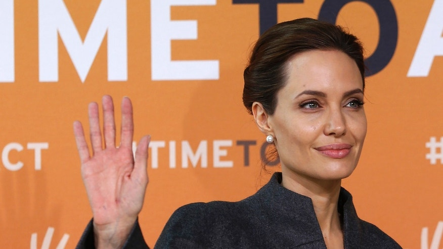 June 13, 2014. Angelina Jolie arrives at a summit to end sexual violence in conflict, at the Excel centre in London.