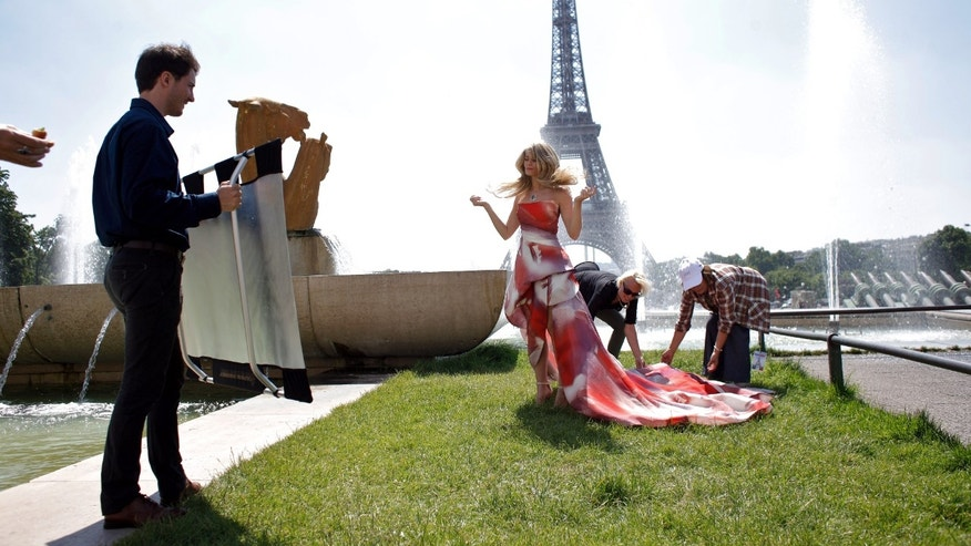 "June 13, 2014. ""The Bold and the Beautiful"" cast member Kimberly Matula, center, is prepared prior to film a scene, in the Trocadero gardens, in Paris."