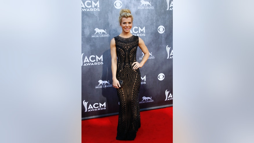 April 6, 2014. Kimberly Perry of the country group The Band Perry poses as she arrives at the 49th Annual Academy of Country Music Awards in Las Vegas, Nevada.