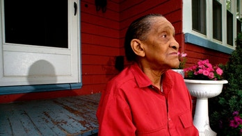 "FILE - In this Friday, June 18, 2004 file photo,  Jazz legend Jimmy Scott poses for a portrait at his home in Euclid, Ohio.  Scott, a jazzman with an ethereal man-child voice who found success late in life with the Grammy-nominated ""All the Way,""died on Friday, June 13, 2014. He was 88. (AP Photo/Jamie-Andrea Yanak)"