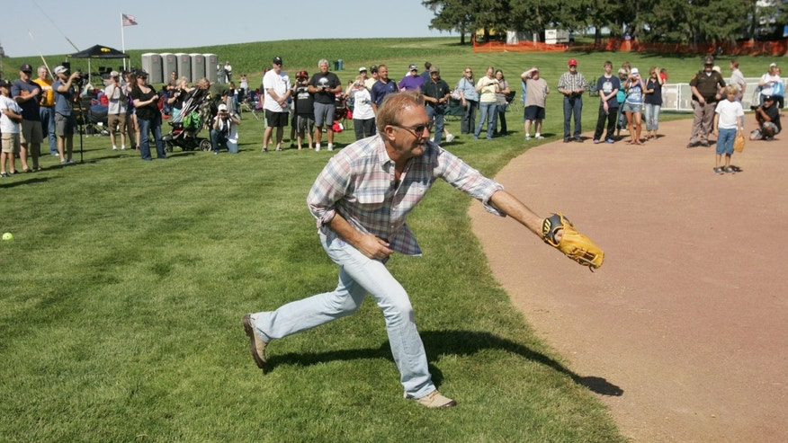 "June 13, 2014. Kevin Costner makes a back-handed catch as he plays catch with his sons during a party celebrating the 25th anniversary of the ""Field of Dreams"" movie near Dyersville, Iowa."