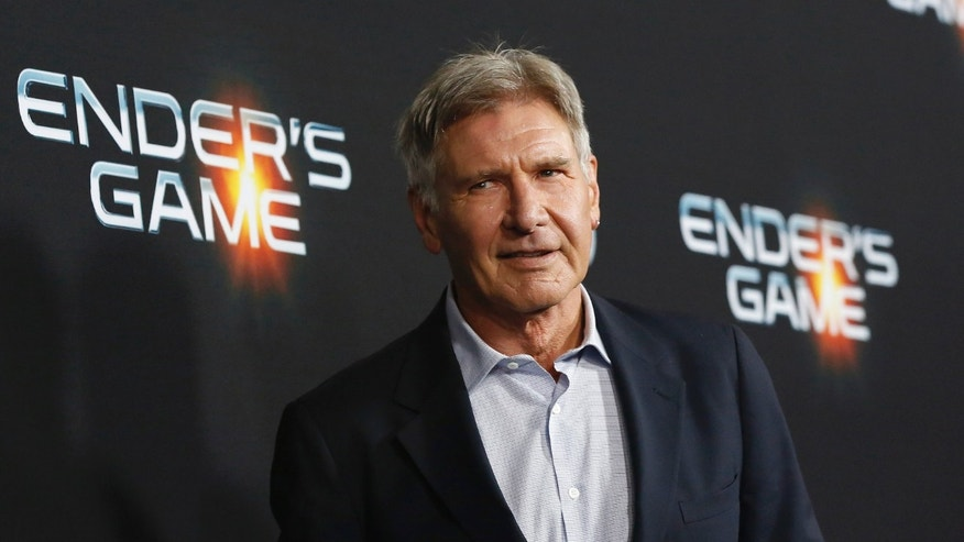 "October 28, 2013. Cast member Harrison Ford poses at the premiere of ""Ender's Game"" at the TCL Chinese theatre in Hollywood, California."