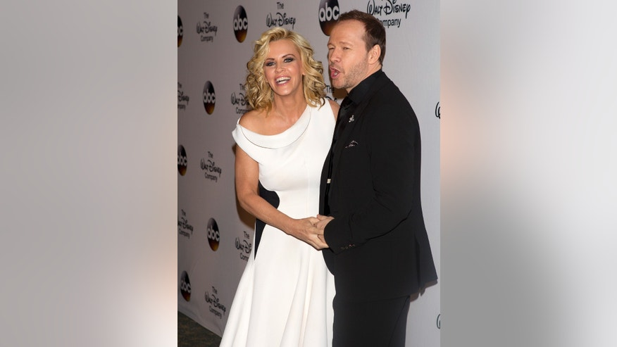 "Actress Jenny McCarthy and fiance actor Donnie Wahlberg arrive for ""A Celebration of Barbara Walters Cocktail Reception"" in New York May 14, 2014. Walters is set to retire after more than 5 decades in journalism.  REUTERS/Carlo Allegri (UNITED STATES - Tags: ENTERTAINMENT) - RTR3P7SC"