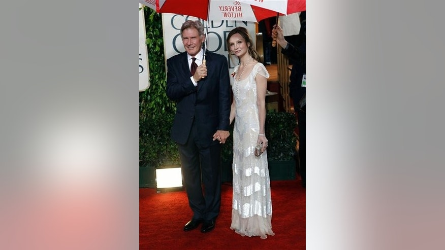Harrison Ford, left, and Calista Flockhart arrive at the 67th Annual Golden Globe Awards on Sunday, Jan. 17, 2010, in Beverly Hills, Calif. (AP Photo/Matt Sayles)