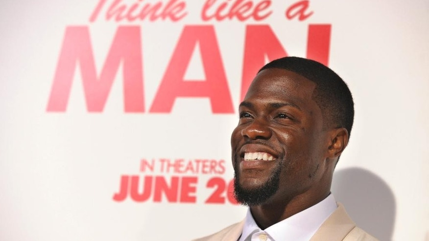 "FILE - In this Monday, June 9, 2014 file photo, Kevin Hart, a cast member in ""Think Like A Man Too,"" poses at the premiere of the film at the TCL Chinese Theatre in Los Angeles. The film, which opens Friday, June 20, 2014, also stars Gabrielle Union, Taraji P. Henson, Michael Ealy, Adam Brody and Megan Good. (Photo by Chris Pizzello/Invision/AP, file)"