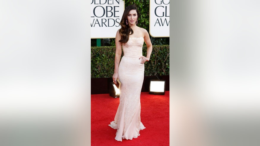 January 13, 2013. Actress Megan Fox poses as she arrives at the 70th annual Golden Globe Awards in Beverly Hills, California.