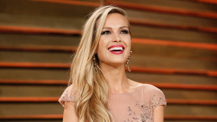 March 3, 2014. Model Petra Nemcova arrives at the 2014 Vanity Fair Oscars Party in West Hollywood, California.