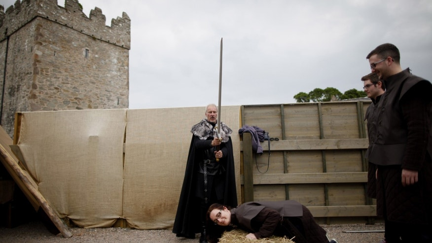 June 13, 2014. William Van der kells from Clearsky Adventure entertains Game of Thrones tourists at an exact replica of Winterfell Archery range in the same spot where filming took place for the Game of Thrones at castleward, Strangford, Northern Ireland.