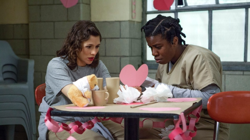 "Yael Stone, left, and Uzo Aduba in a scene from ""Orange is the New Black."""