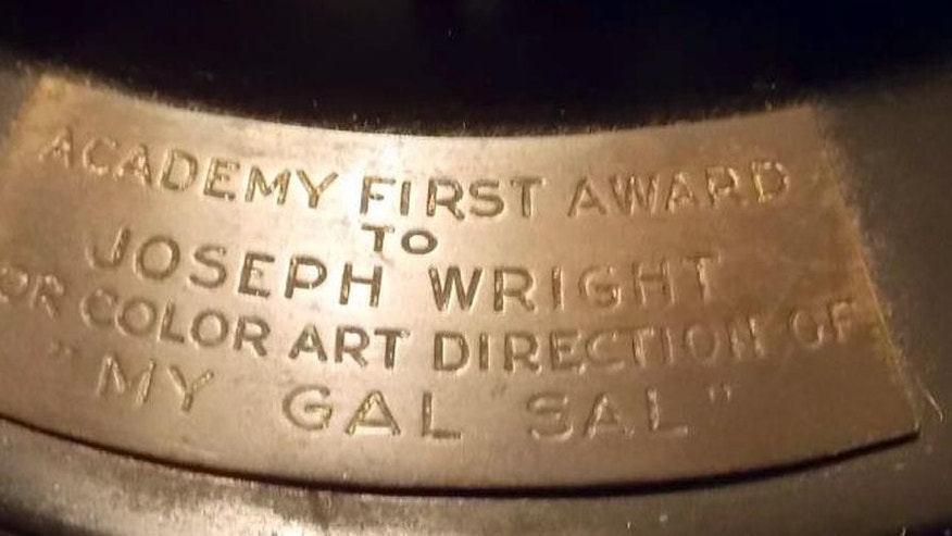 "This undated photo released by Briarbrook Auctions shows a portion of an Academy Award Oscar statue awarded for color art direction in 1942 to Joseph C. Wright for his work on ""My Gal Sal."" The statuette is being auctioned in Rhode Island Monday evening, June 23, 2014, by Wright's nephew. Wright died in 1985. The Academy of Motion Picture Arts and Sciences does not allow an Oscar statuette to be sold without first offering it back to the academy for $1. But the auction house said that restriction does not apply to awards before 1950. (AP Photo/Briarbrook Auctions)"