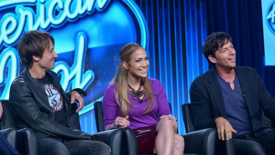 "FILE - In this Jan. 13, 2014 file photo, judges, from left, Keith Urban, Jennifer Lopez, and Harry Connick Jr. are seen during the panel of ""American Idol"" at the FOX Winter 2014 TCA, at the Langham Hotel in Pasadena, Calif. Lopez, Urban, and Connick Jr. will return as judges with Ryan Seacrest hosting for the 14th season of Fox's ""American Idol.""  (Photo by Richard Shotwell/Invision/AP, file)"