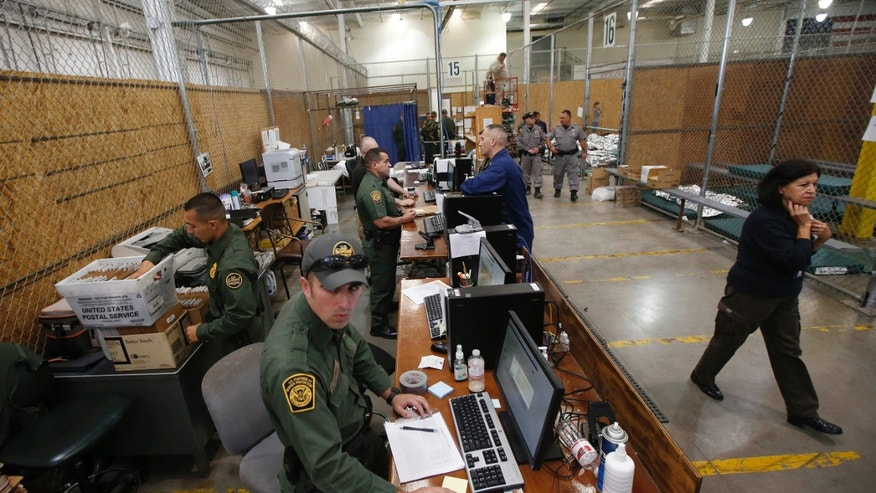 Officers at the U.S. Customs and Border Protection Nogales Placement Center on June 18, 2014, in Nogales, Ariz.