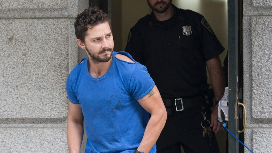"Actor Shia LaBeouf leaves Midtown Community Court after being arrested the previous day for yelling obscenities at the Broadway show ""Cabaret"" Friday, June 27, 2014, in New York."